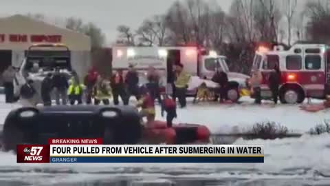 5 p.m.: Four pulled from submerged vehicle