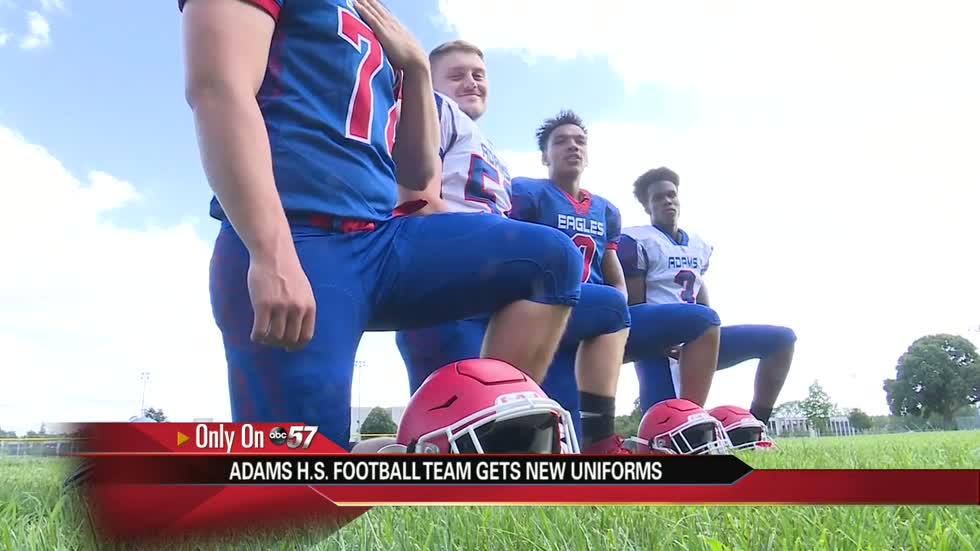 Adams High School unveils new football jerseys, safer helmets for players
