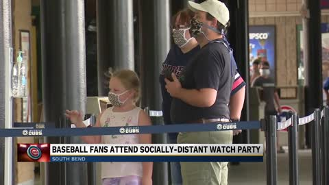 Baseball fans attend socially-distant watch party
