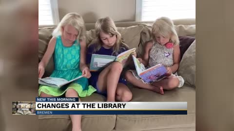 Library dedicating book to newborn babies