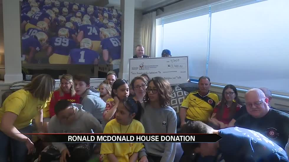 Clay firefighters present check, cook Easter meal at Ronald McDonald House