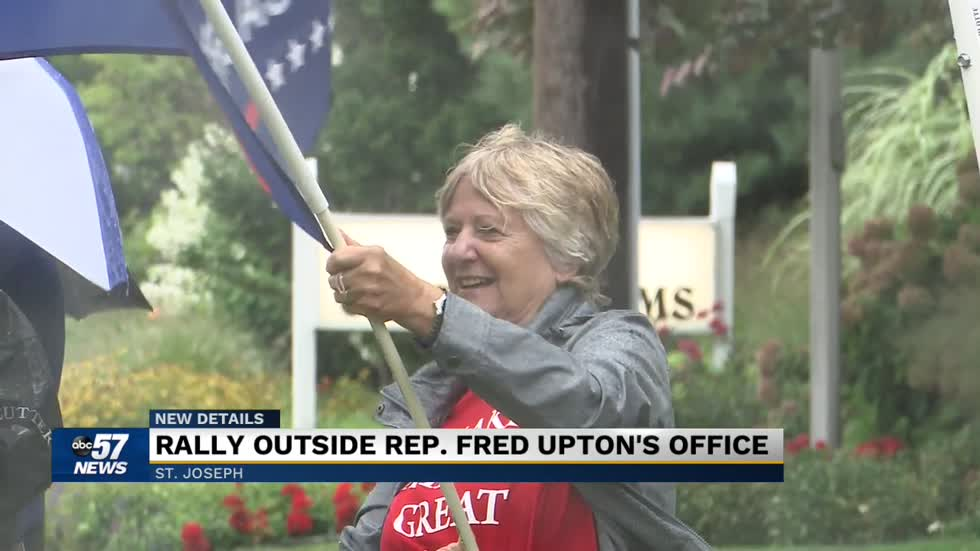 Demonstrators rally outside Fred Upton's office