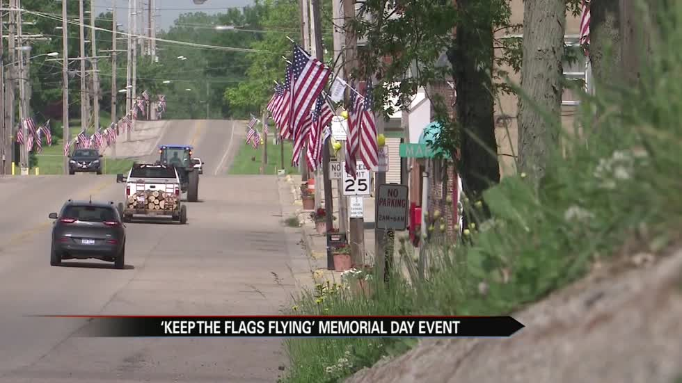 Dozens of flags line Main Street for annual Eau Claire veteran tribute