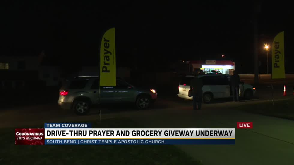 Drive-thru prayer and grocery giveaway