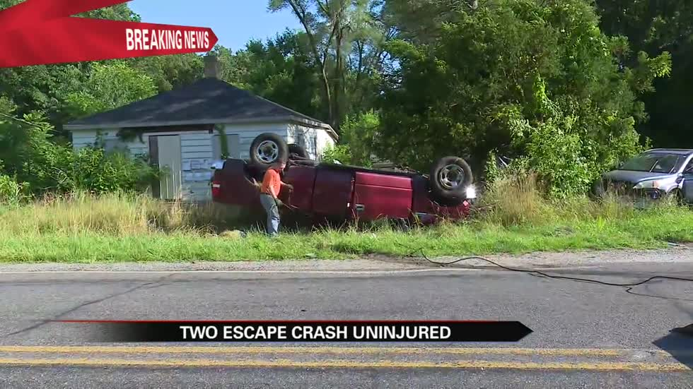 Driver, passenger uninjured after rollover crash