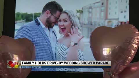 Family holds drive-by wedding shower parade