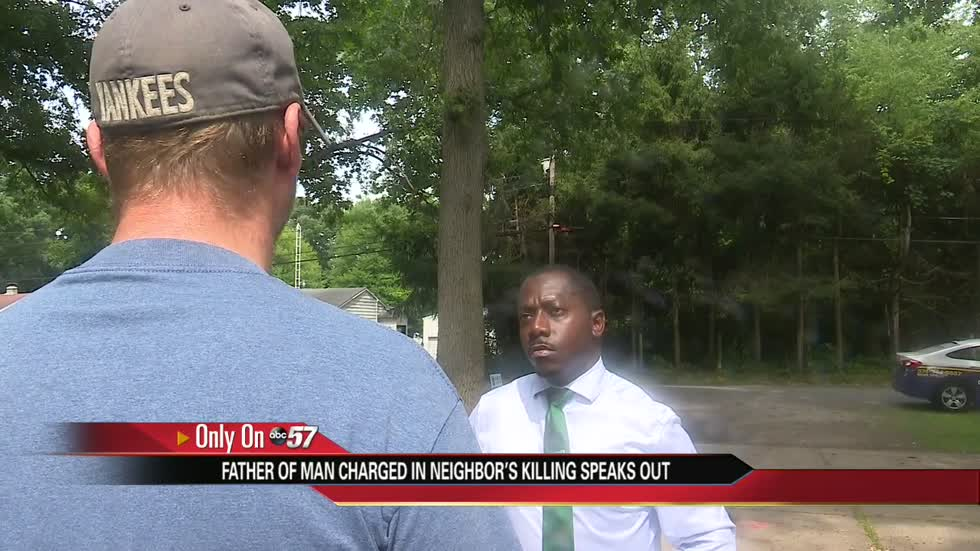 Father of man charged in neighbor's killing speaks out