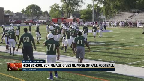 High school football scrimmage gives glimpse of new normal