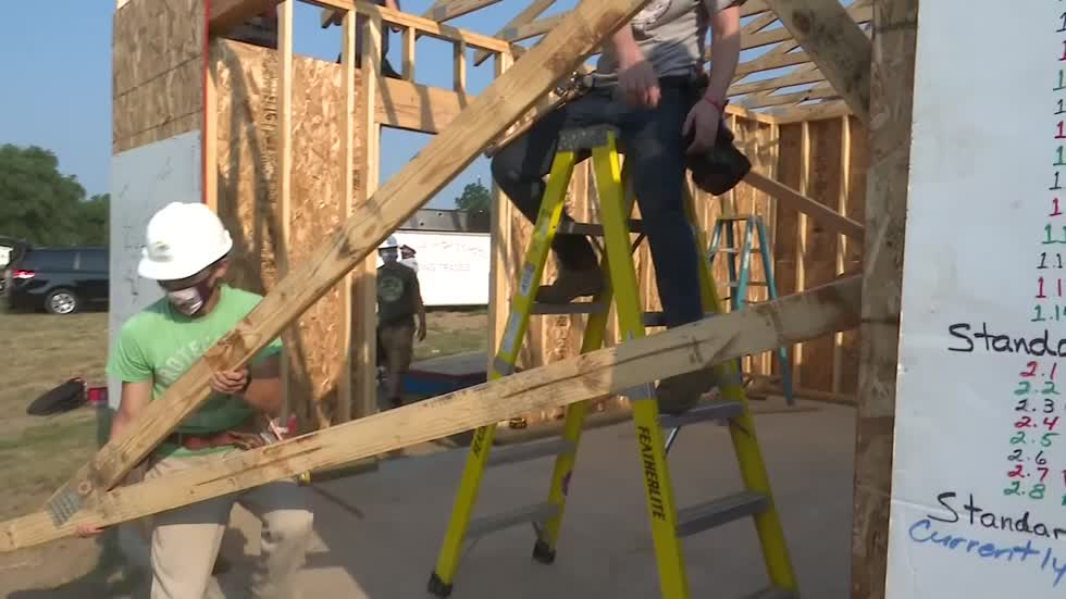 High school students help build homes for families in need
