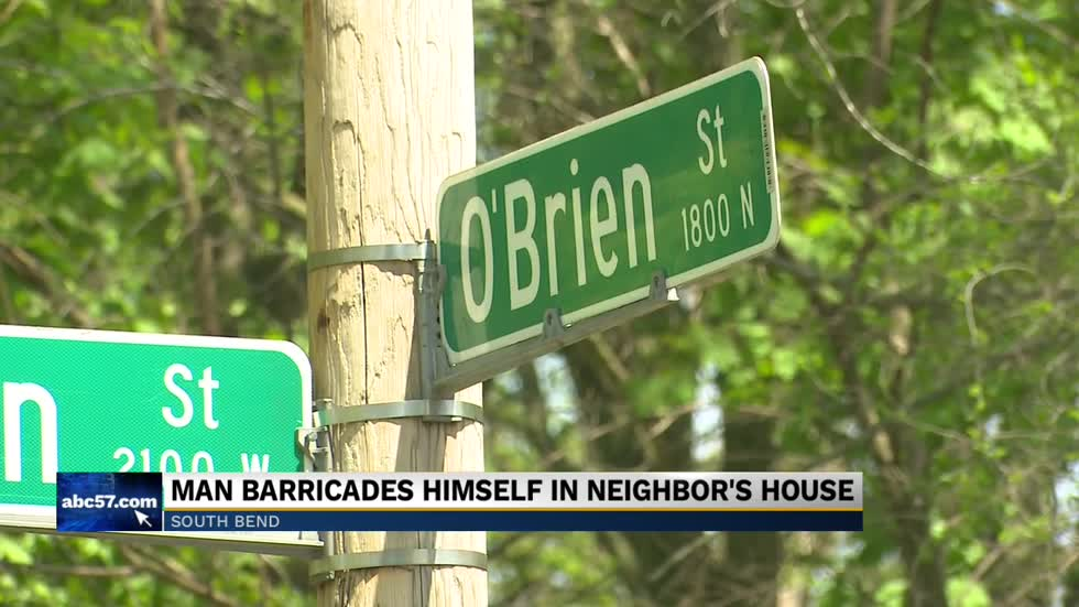 Man barricades himself in neighbor's house