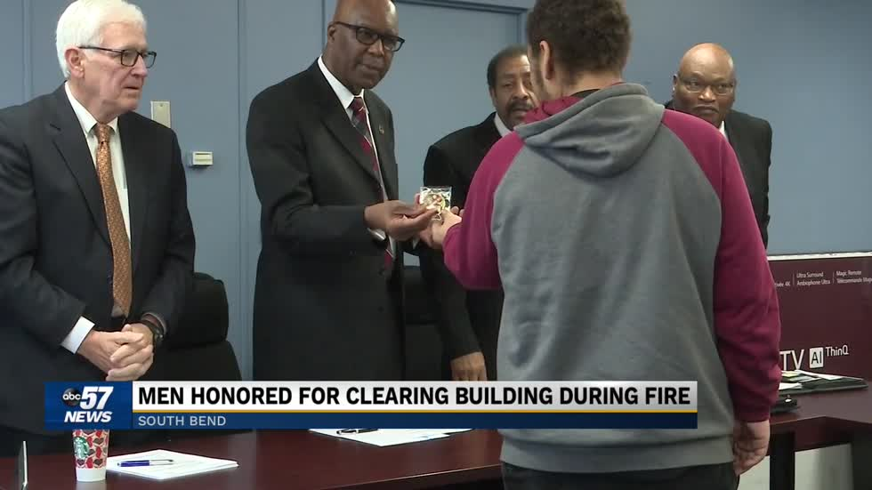 Men honored for heroism during a Christmas fire