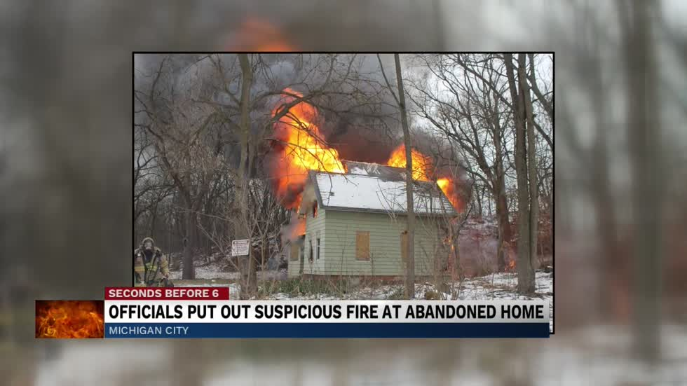 Michigan City firefighters investigate cause of abandoned house...
