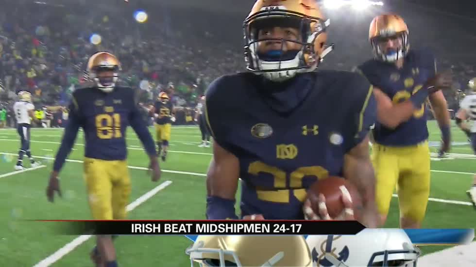 Notre Dame outlasts Navy on rain-soaked Senior Day