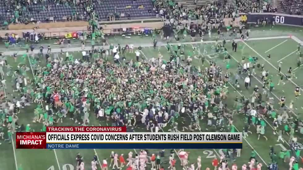 Officials express COVID concerns after students rush field post Clemson game