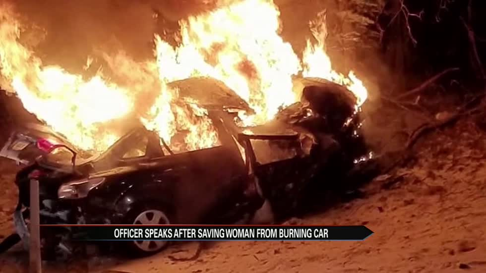SJC officer recalls rescuing woman from burning car