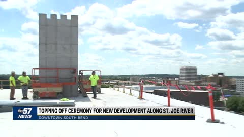 South Bend officials, community members top off new downtown...
