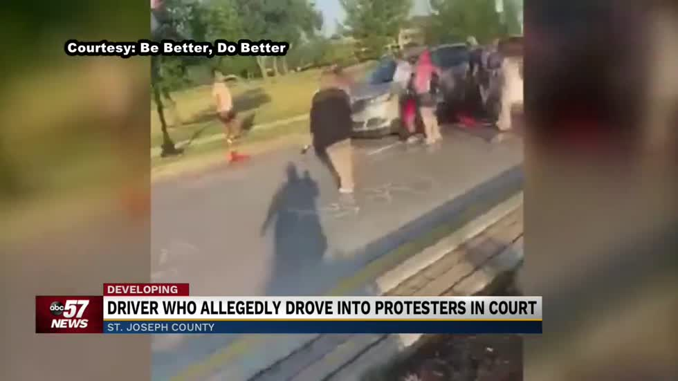 The driver who allegedly drove through a group of protesters makes his first court appearance