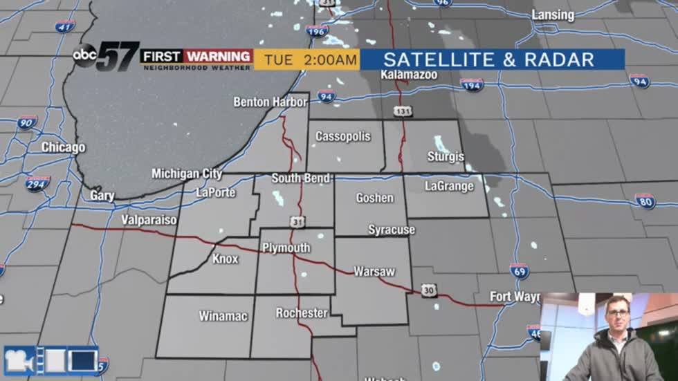 Flurries and drizzle Tuesday with no below average temps in sight