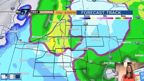 Rain turning to wintry mix and breezy