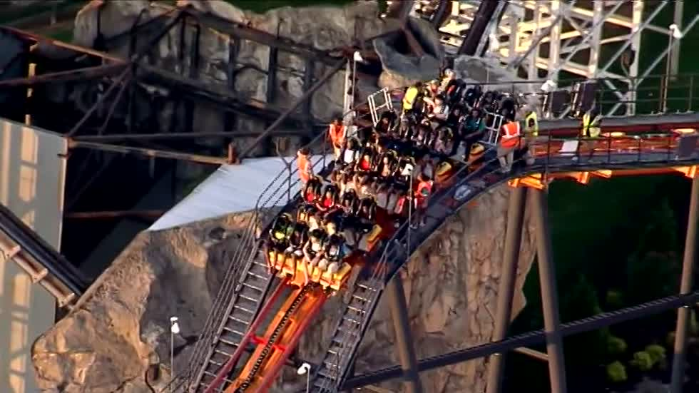 Six Flags roller coaster gets stuck at top of lift hill