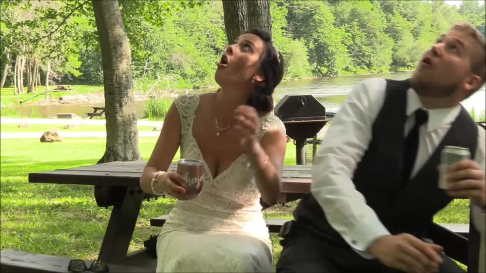 Caught on camera: Newlywed couple narrowly misses being seriously hurt by falling tree branch