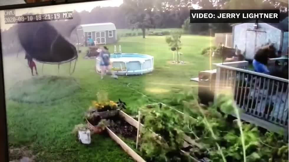 VIDEO: Man narrowly escapes being blown away with trampoline