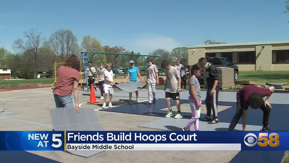 Bayside Middle School students help build basketball court in...