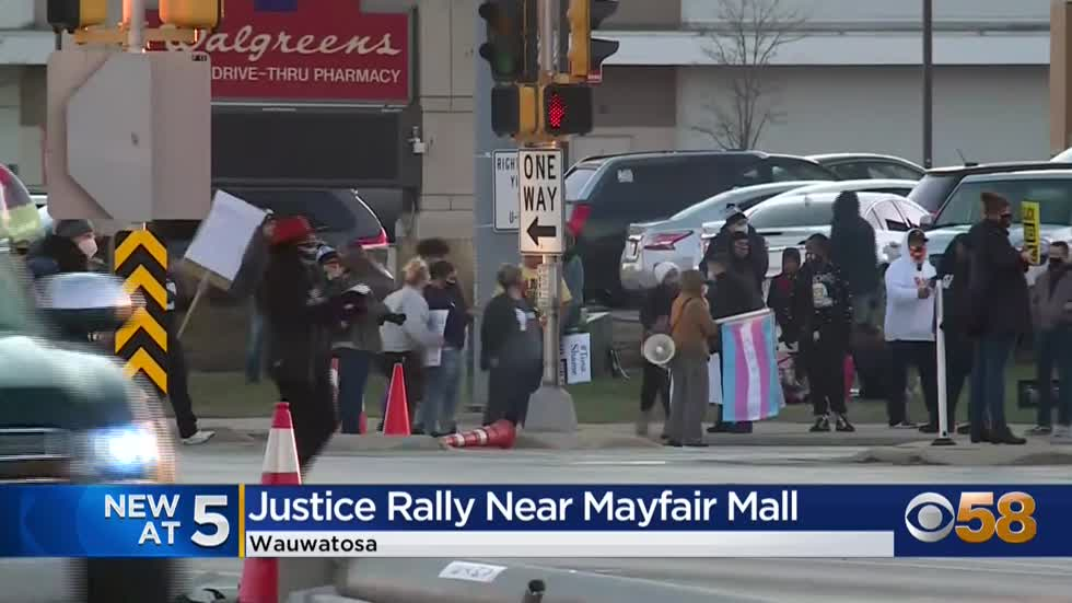 Group gathers for justice rally near Mayfair Mall