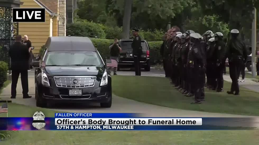 Fallen officer's body taken to funeral home, escorted by police