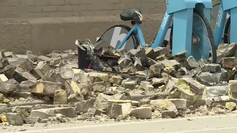 MPD: Truck hits building on city's north side sending bricks tumbling onto sidewalk