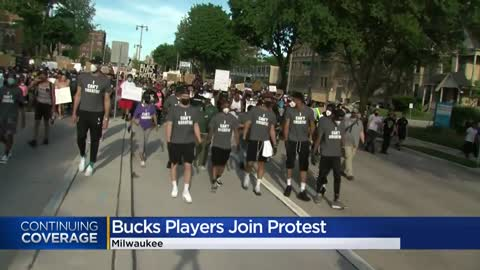Bucks players join protesters in Milwaukee march for social justice