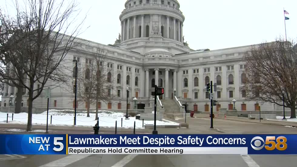 Wisconsin lawmakers hold public hearing at Capitol despite warning...