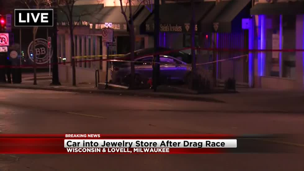 Car crashes into downtown Milwaukee building after drag race, unmarked squad car hit