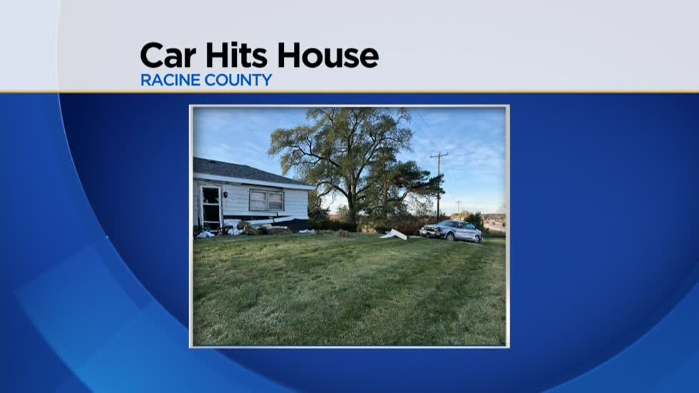 Car slams into house with people inside in Racine County