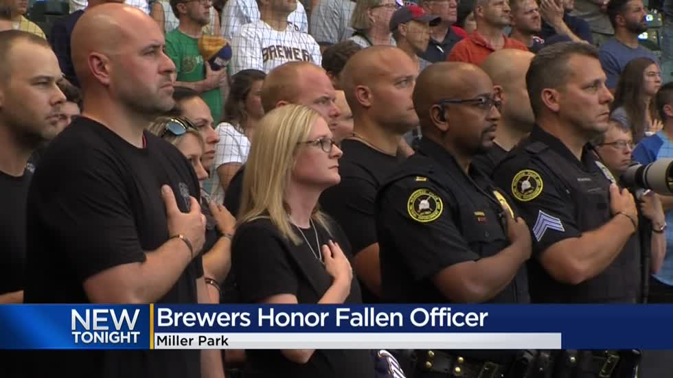 Widow of fallen Milwaukee Police Officer Rittner throws out first pitch at Brewers game