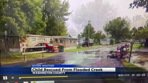 Caught on dash cam: Jackson Police rescue boy, 9, from flood waters