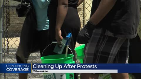 'This is our form of protest': Milwaukee residents paint murals, clean up neighborhoods