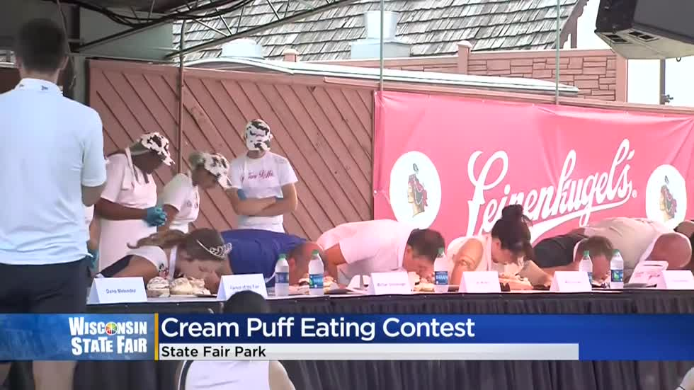 CBS 58's Michael Schlesinger competes in cream puff eating competition at State Fair