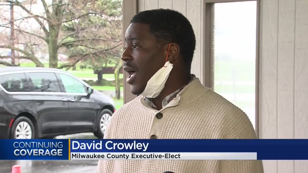 Milwaukee County executive-elect David Crowley distributes meals to seniors