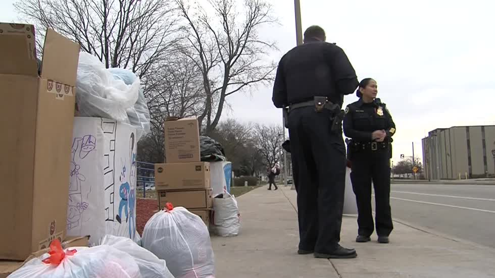 Milwaukee Police Officers collecting clothing for the homeless