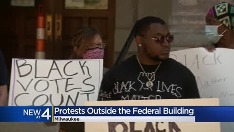 Protesters rally against voting restrictions outside Milwaukee...