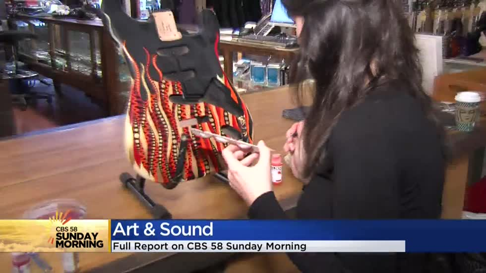 Milwaukee artist inspires with hand-painted guitars