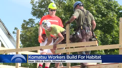 Volunteers help build Habitat for Humanity homes for families from Myanmar