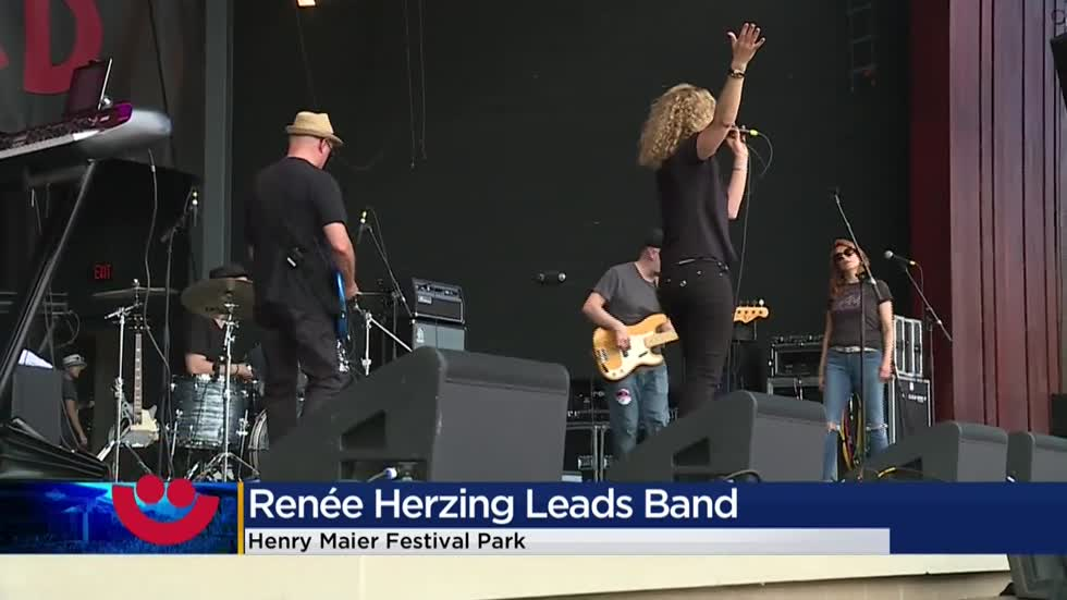 Herzing University president performs with group at Summerfest