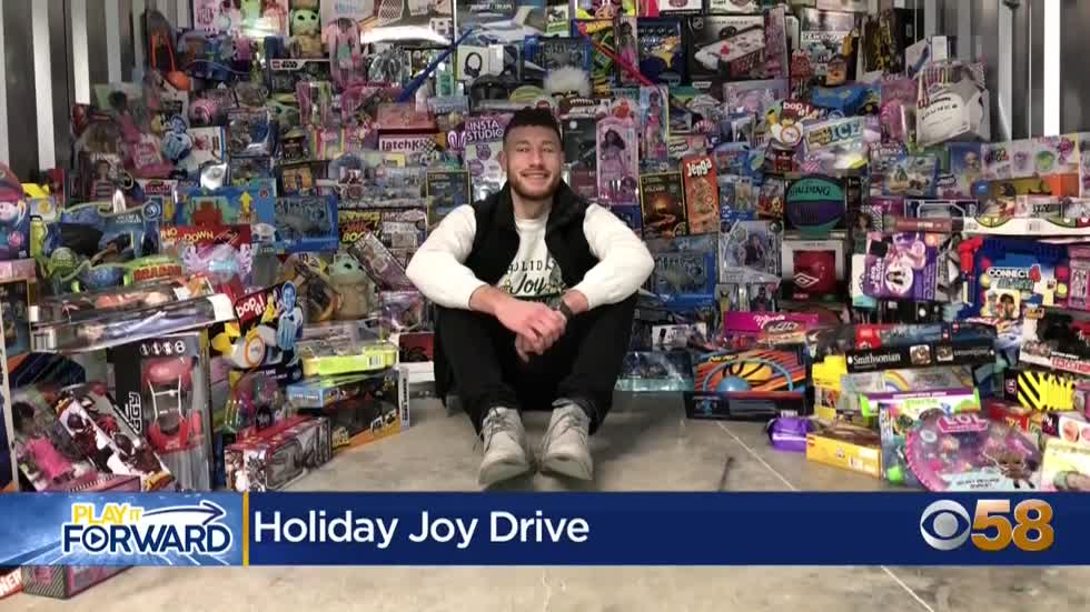 Former Badgers MBB manager donates $12,000+ worth of presents through Holiday Joy Drive
