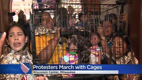 LULAC demonstrators march with cages to Senator Ron Johnson's office