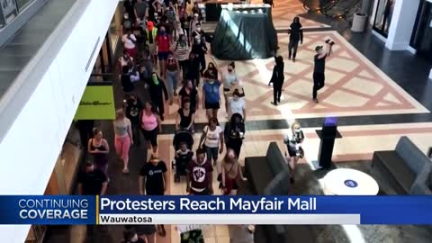 Protesters gather inside Mayfair Mall, demanding justice for those killed by Wauwatosa police