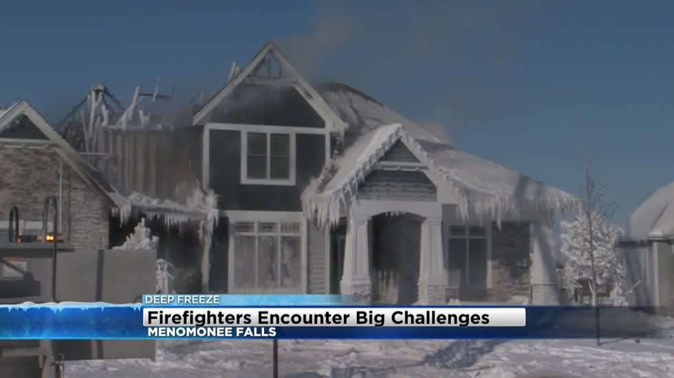 Crews battle Menomonee Falls house fire in freezing temps