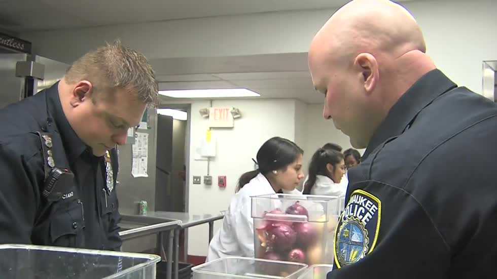 Messmer High School students join Milwaukee Police Officers to prepare Thanksgiving meals
