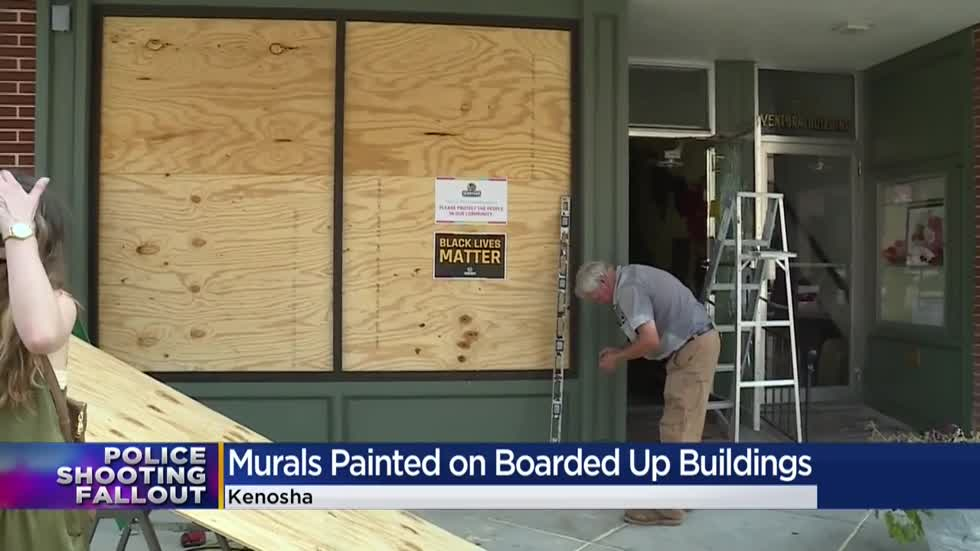 Boarded-up businesses provide canvasses for uplifting art in Kenosha